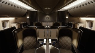 Centerline view looking aft of the business class interior dimly lit