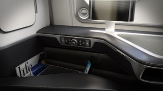 Closeup view of the seat controls and beautiful black leather in the business class seat